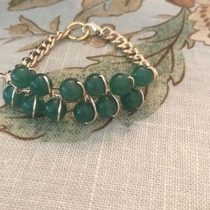Handmade wire wrapped jade bead bracelet.